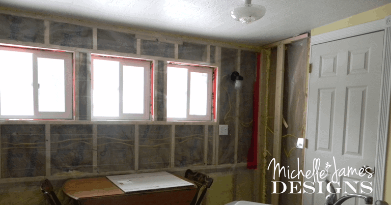 New Wall with insulation and plastic - www.michellejdesigns.com - #kitchenremodel