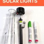 A vase, a solar light and oil based sharpie markers to make diy outdoor solar lights.