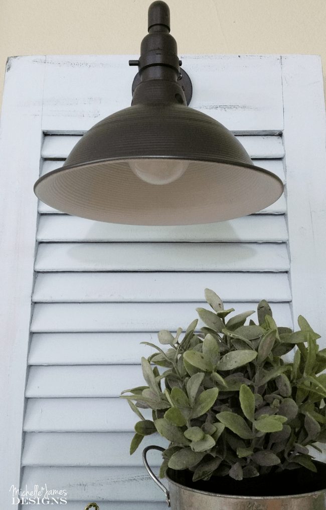 DIY Shutter Sconces - www.michellejdesigns.com - I created my own sconces from plumbing and electrical parts. They are perfect in the shutters...on the wall!