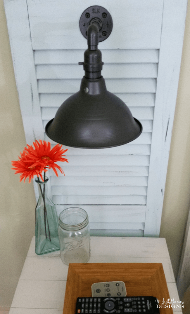 DIY Shutter Headboard - www.michellejdesigns.com - See how I created a headboard and bedside table sconces by using garage sale shutters!