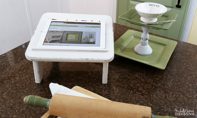 IPad Holder - www.michellejdesigns.com - I created this farmhouse ipad -tablet holder from a footstool I purchased at a flea market. I love it in the kitchen when I am working on a recipe!