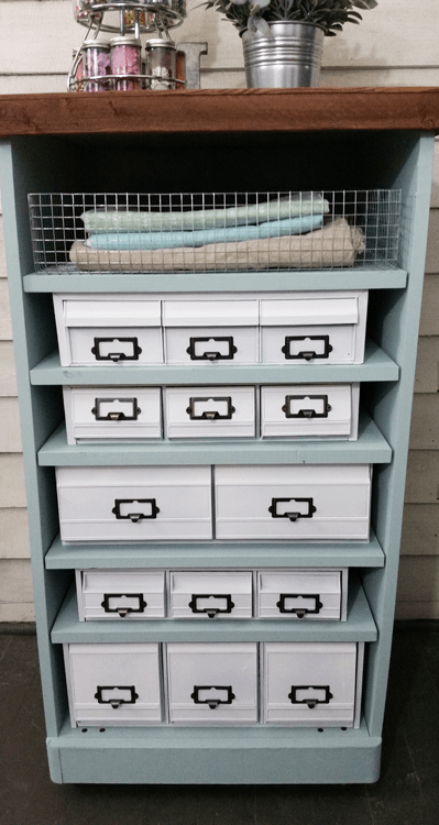 Craft Organizer - www.michellejdesigns.com - I found a bunch of the old 80's cassette, cd and vhs holders and gave them a cohesive look to create this awesome craft organizer!