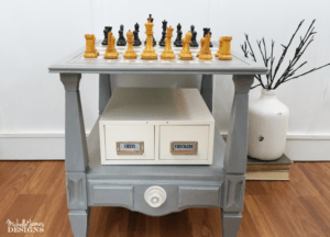 I used a HomeRight paint sprayer, some spray paint and some masking materials to paint a chess and checkers board. This was a fun DIY game table that anyone can create!