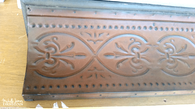 Close up view of the metal shelf before it is painted.