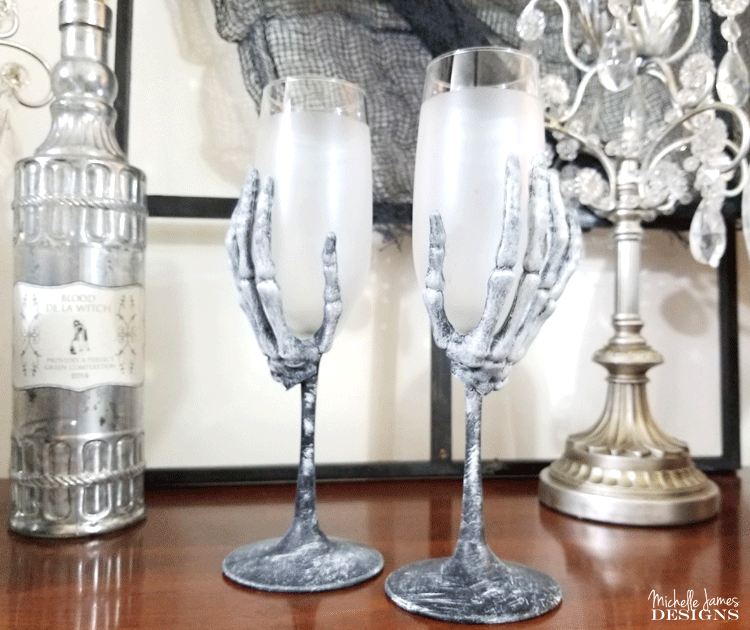 With a few supplies from the Dollar Store you are will on your way to creating some creepy skeleton wine glasses for your Halloween decor - www.michellejdesigns.com