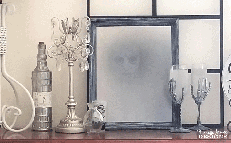 Create a haunted Halloween mirror this season. This DIY Halloween mirror will creep out your friends and family! - www.michellejdesigns.com