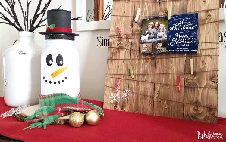 Take a look at my fun snowman mason jar craft. He is tall, festive and the perfect addition to my holiday decor. - www.michellejdesigns.com