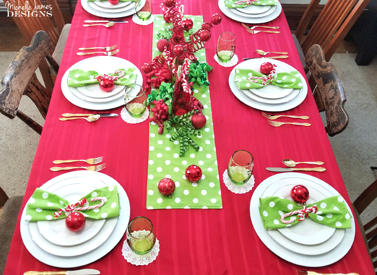 This year I decided to include a theme and create a fun table. I love my Grinch inspired table setting and I think my family will too! - www.michellejdesigns.com