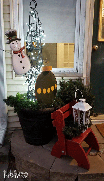 Each year I try to create some Holiday porch decor. It is my back door where friends come into the house. I try to make it festive and fun! - www.michellejdesigns.com