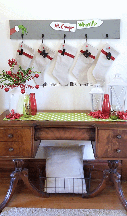 This DIY Grinch Inspired Stocking Wall Hanger is super cute and is the perfect touch if you don't have a mantel! www.michellejdesigns.com - #michellejdesigns #stockinghanger #grinchstockinghanger