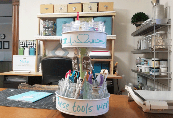 Full view of tiered craft organizer made from upcyled pans. It is full of my favorite crafting tools.