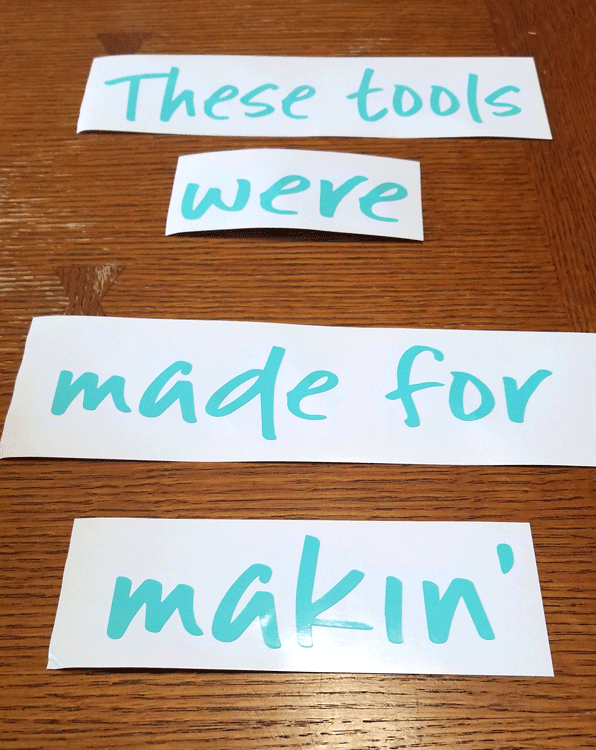 "Teal vinyl pieces that read ""these tools are made for makin'"" to add to the sides of the white pans"