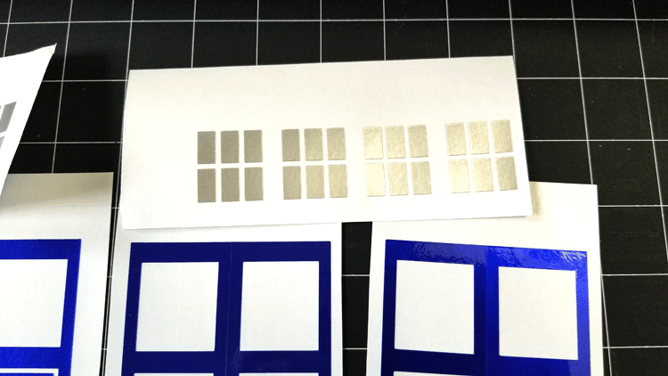 Silver polished metal vinyl cut into window panes.