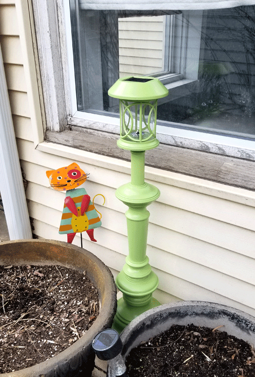 Cute apple green solar lamp post by the back door.