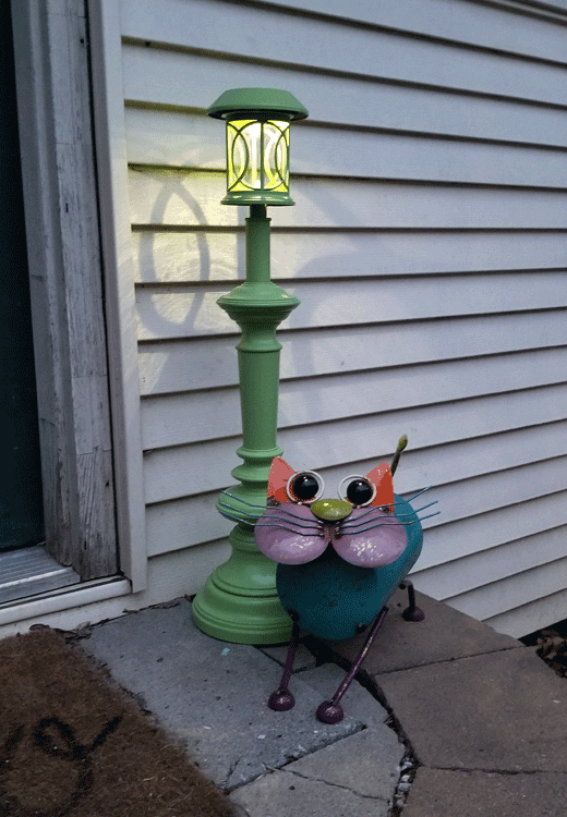 Solar lamp post by the back door just as it starts to get dark.