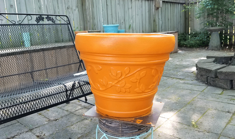 The large orange foam painted flower pot after two coats of DecorArt Outdoor Living paint.