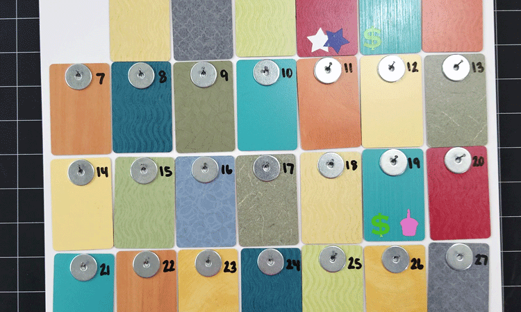 The formica samples wall calendar with some vinyl stars, a cupcake and a dollar sign to mark 4th of July, a birthday and our paydays.