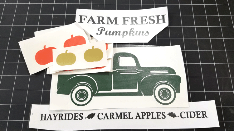 The fall vintage truck and pumpkins all cut out and ready to hang on the wall in the fall.