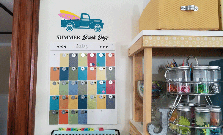 Front view of the finished, colorful formica sample wall calendar with the summer seasonal vintage truck design added to the wall above it.