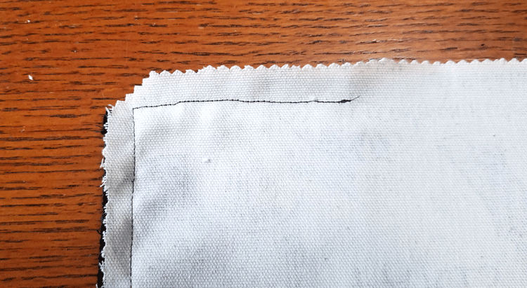 Seams on the back of the chair with a clipped corner before turning it right side out.