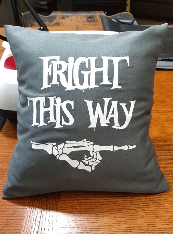 Close up of finished gray and white Fright This Way pillow