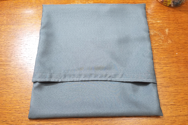 Gray pillow cover before stitching the sides