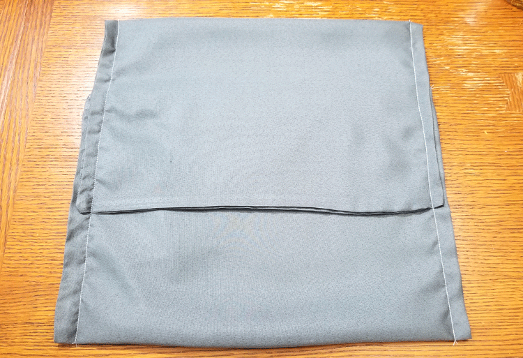 Gray pillow cover with stitched sides