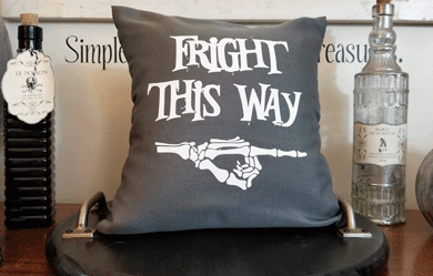 Fright This Way Throw Pillow cover using a gray pillowcase from the dollar store.