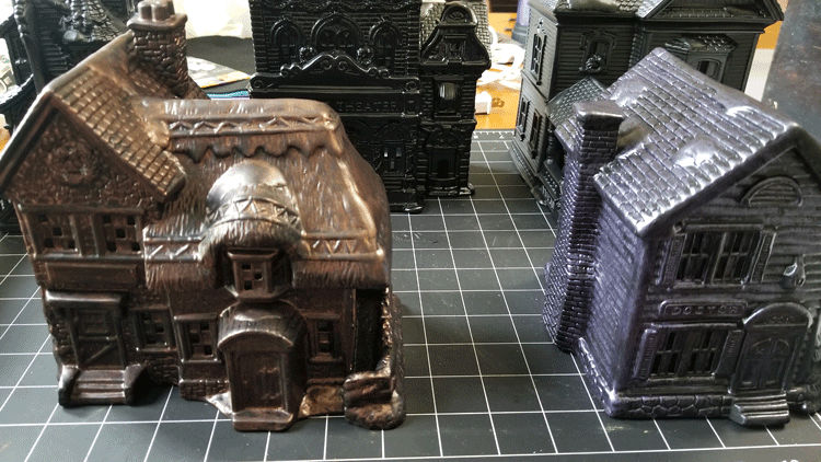 Different metallic paint colors on the different village pieces.