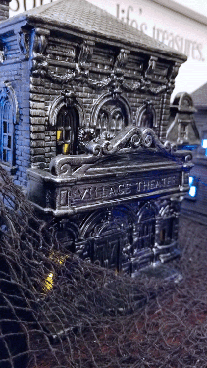 Close up of lighted Halloween village pieces on display