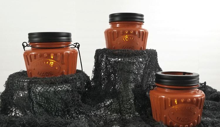 Finished orange pumpkin tea lights with black spooky netting.