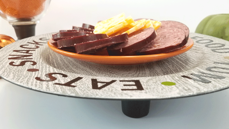 Finished plastic charger plate buffet tray with meat and cheese.