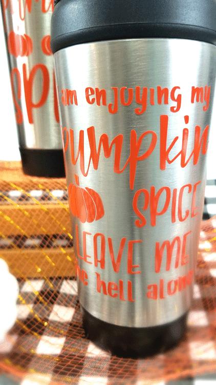 Close up of cheap travel mug with pumpkin spice saying