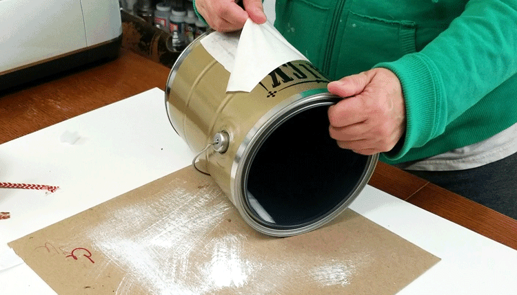 Adding vinyl design to front of paint can