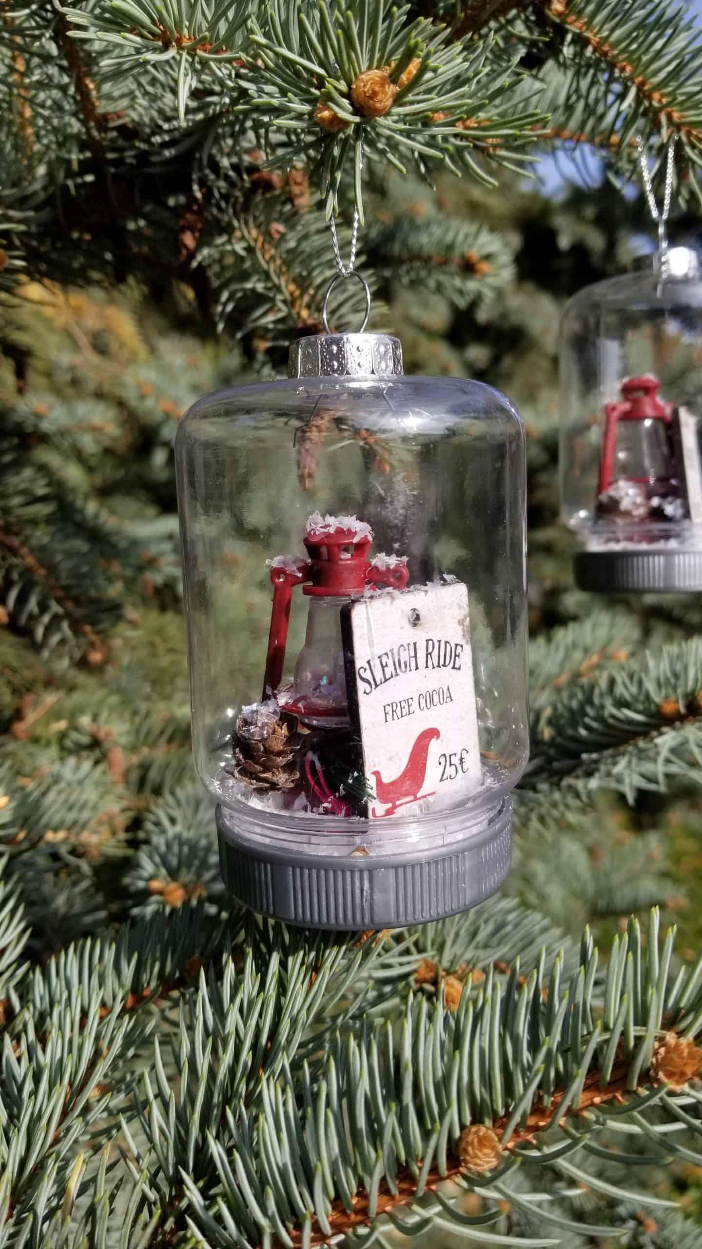 Finished mason jar ornament hanging on a tree.