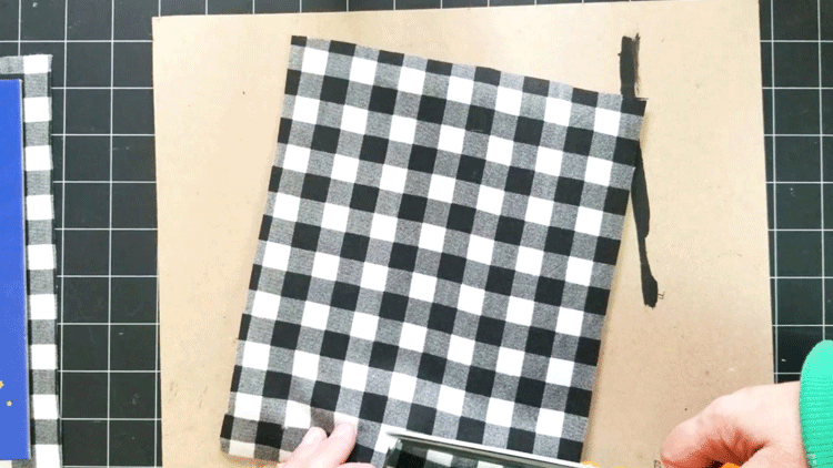 Cutting a notch in the fabric for the base of the clip.