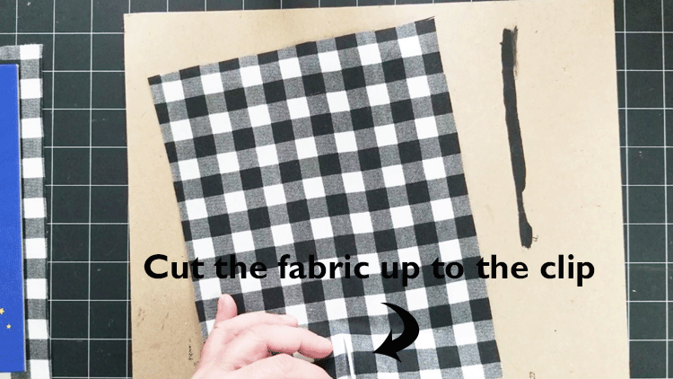 Cut the fabric from the edge up to the clip.