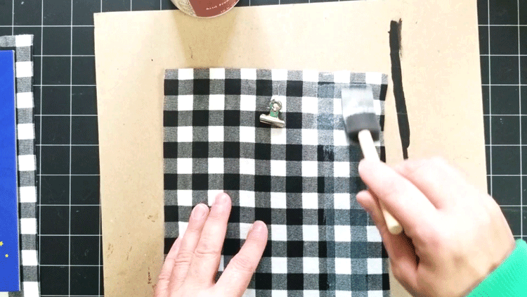 Adding Mod Podge over the fabric to create a seal.