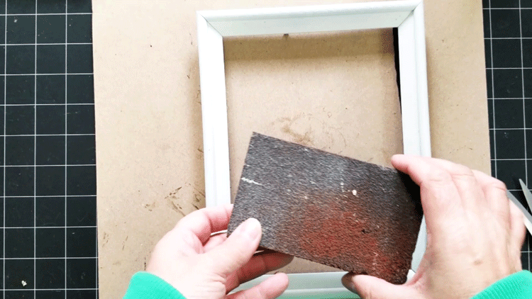 The sanding block used to distress the white frames.