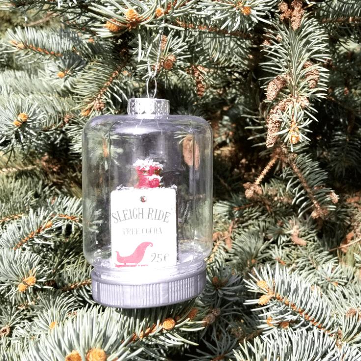 Dollar Tree mason jar ornament hanging on a tree.