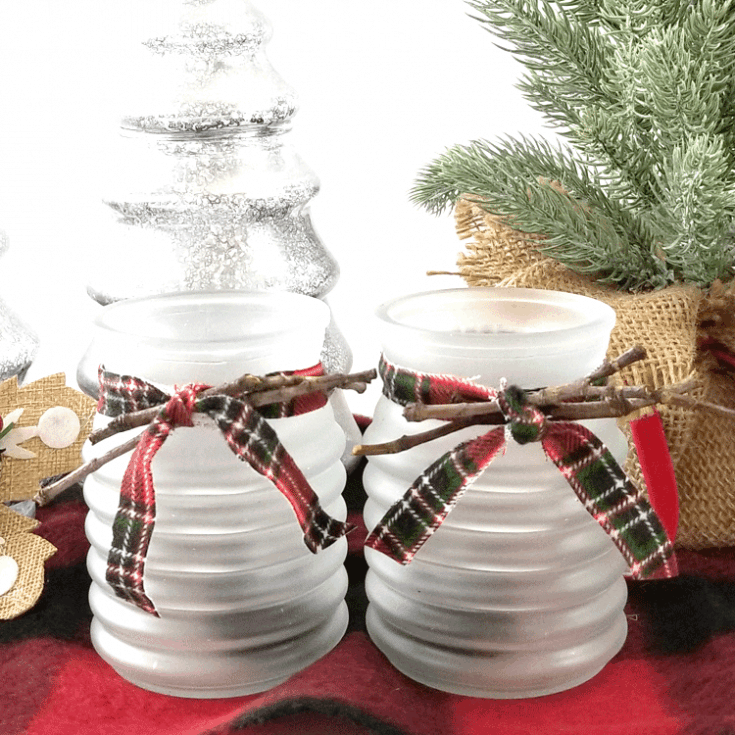 Finished frosted glass tea light candle holder with red plaid flannel fabric ribbon.