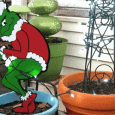 Finished Grinch Yard Art for my back door decor.