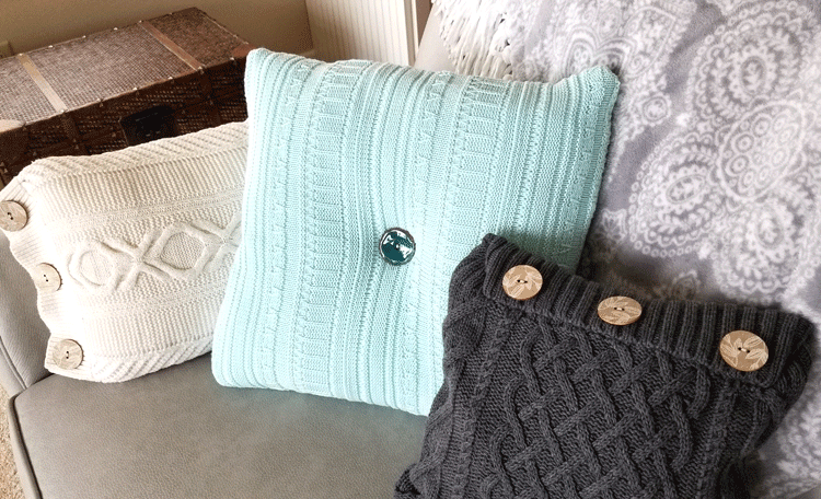 Finished sweater pillows displayed on a gray sofa