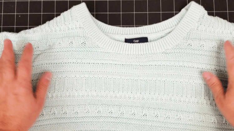 The sweater before making it into a sweater pillow