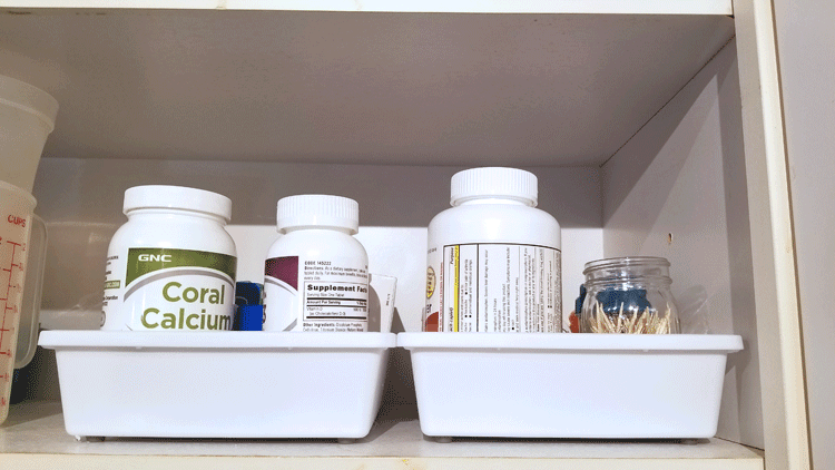Dollar Store drawer trays to organize meds in cupboard