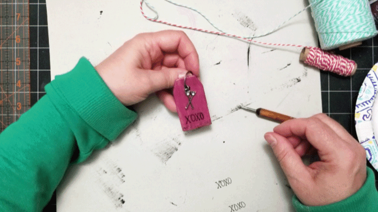 Adding an arrow charm to the painted wood tag.