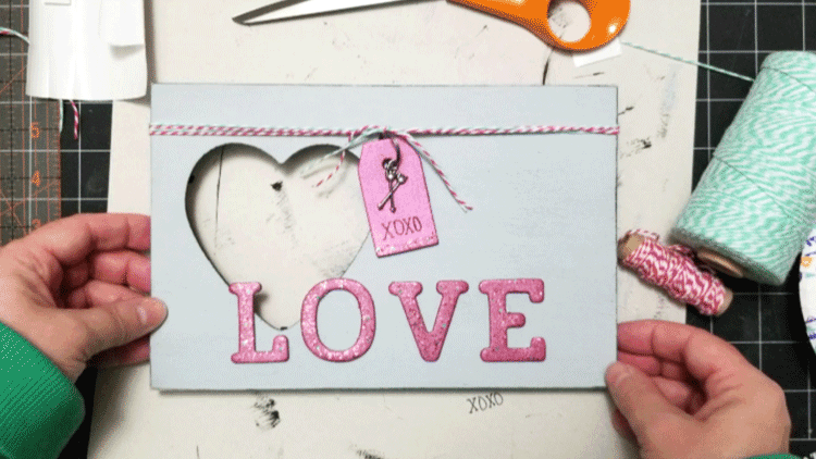 The finished painted and decorated dollar store picture frame.