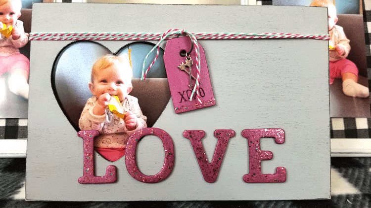 Finished Dollar Store Picture Frame all decorated with glitter letters and a fun tag.