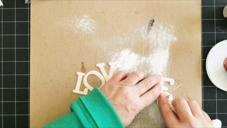 Using the wood letters from the Dollar Tree to spell out LOVE.