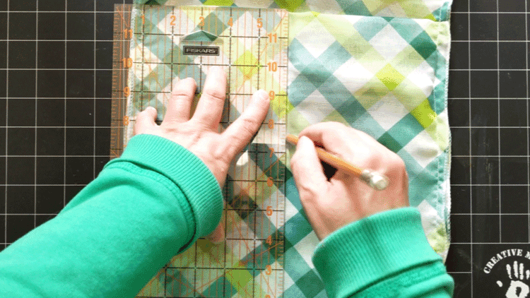 Drawing a chalk line to stitch down the center of the bag.